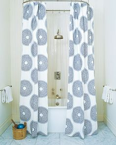 My dream bathroom involves a massive victorian tub. I love the updated shape of this big tub, with the shower head hung above. The shower curtains are fab echoes of the rounded tub and shower head.