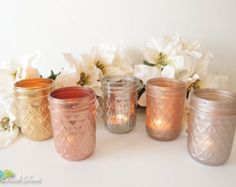 These gorgeous mason jars are hand-painted by me and distressed for a shabby chic, cottage and beach feel. They are perfect for garden parties, showers, weddings and more. You may use water and fresh flowers in them as they are only painted on the outside.  I pride myself in creating unique colors and styles of painted and distressed shabby chic mason jars. Beach Blues is the home of the original! This is a unique and one of a kind color combination and title created by me. Unauthorized use…