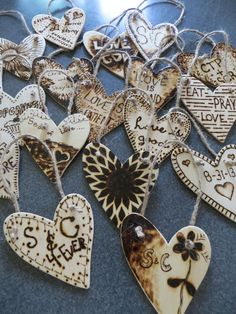 Christmas Decorations  burned Wood | Wood burned wooden hearts, sprayed w/ polyurethane and tied w/ twine ...