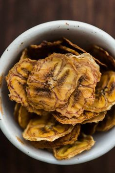 Baked Banana Chips without added sugar- just bananas baked with a bit of lemon juice. Perfect snack for hiking, travel, or work!
