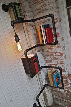 Pipe & Light Shelving. Reminds me of starving artists, Rent, and fingerless gloves :)