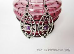 Earrings: stainless steel, copper, glass beads and amethyst.