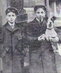 Groucho and Harpo Marx with their fox terrier.