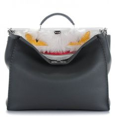 This is an authentic FENDI Calfskin Romano Lamb Fur Crocodile Large Monster Selleria Peekaboo in Grey.  This stylish tote is crafted of grey calfskin leather.