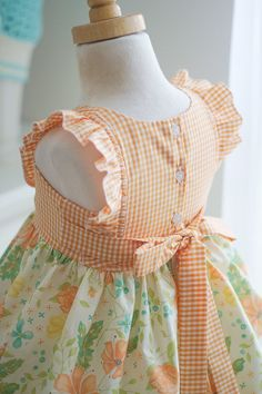 NEW 2017 Girls handmade Clementine Dress. Lovely shades of aqua and orange on a creamy color floral background fabric. Details include: Flutter Sleeves Sewn-in Sash Cotton Fabric Made in the USA. Published using Nembol Frock Design, Ladies Dress Design, Dresses Kids Girl, Kids Outfits, Sewing Clothes, Doll Clothes, Fairytale Dress, Girl Dress Patterns, Handmade Dresses