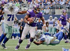 Minnesota Vikings running back Adrian Peterson runs over the cowboys.