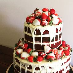 2 Tier Red Velvet cake layered with cream cheese butter frosting. Surrounded by beautiful fresh strawberries, dipped in whoc chocolate.