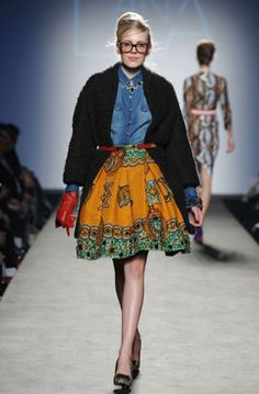 Like the look with the jeans shirt and the African print skirt