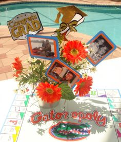 graduation table centerpiece-like the pictures in the flowers
