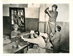 1943- U.S. Signal Corps troops set up telephone switchboard immediately following Allied capture of Bizerte, North Africa.