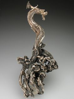 Kongsberg, Norway is famous for its Native Silver, and this specimen is the perfect example of why - a solid weighty specimen of thick ropy Native Silver with fantastic natural patina, and very attractive form - we think it looks like a dragon. And with a size of nearly 11cm height, this specimen will not go unnoticed!