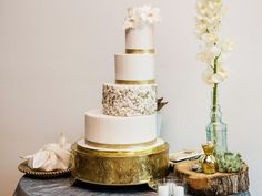Gold leaf decorated staircase wedding cake. Perfect for a rustic or gold inspired wedding.