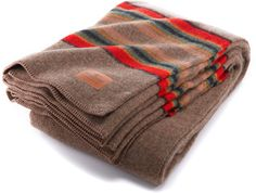 Rugged enough for the campground or a kids' living room fort, the Pendleton Yakima wool blanket provides a generous layer of warmth wherever you need it. Available at REI, Satisfaction Guaranteed.