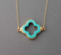 So simple. love it.    Turquoise Four Leaf Clover Gold Necklace also in by jennijewel, $33.00