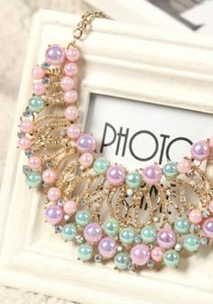 Looking to make a statement with your accessories this season? This pretty pastel chunky necklace will show off your trendy sense of style this spring.
