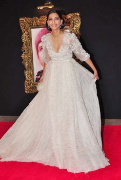 Indian Bollywood film star Sonam Kapoor wears an Elie Saab white dress to the 'Jab Tak Hai Jaan' premiere in Mumbai.    From the ELIE SAAB Haute Couture Spring Summer 2012 collection seen featured at  http://weddinginspirasi.com/2012/01/27/elie-saab-spring-2012-couture/