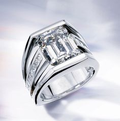 Our contemporary diamond engagement ring features a 5 carat emerald cut diamond in the center. The side princes cut diamonds total .77 carat. This design can be configured for any size or shape of diamond.