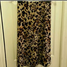 Animal print skirt Flowing A line animal print skirt from Jones New York Collection.  25 inches long size XL.  Cool stretch fabric, stretch slip on waist.  Best color represented in the forth picture. Jones New York Skirts A-Line or Full