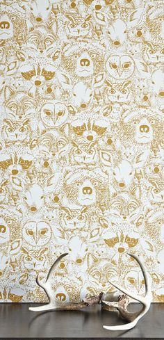 My Menagerie print, who also goes by the name of Wild, over at Chasing Paper. Removable wallpaper tiles, people! Great for crafting, covering books, and, well, wallpaper!!!