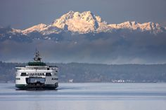 """How we get too and from the """"other side"""". Puget Sound Ferry facing the Olympic Mountain Range, Seattle, WA. USA"""