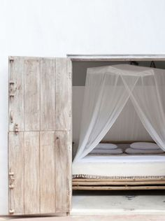= white bed and wood doors