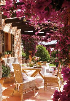 Mallorca - one of my favorite islands. Bougainvillea-covered patio in the home of an architect in Mallorca, the capital city of the autonomous community of the Balearic Islands in Spain (photo by El Meuble) Outdoor Rooms, Outdoor Dining, Outdoor Gardens, Outdoor Decor, Dining Area, Outdoor Patios, Dining Sets, Outdoor Kitchens, Outdoor Ideas