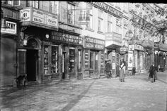 Warszawa sprzed 100 lat - dwujęzyczne szyldy reklamowe na Krakowskim Przedmieściu