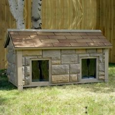 http://www.diyrepairguides.com/how-to-build-a-two-room-dog-house/