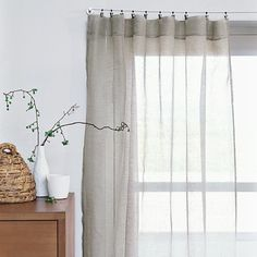 Summer and warm weather requires a change of curtains in our house - away goes the heavy winter canvas and in comes the summer linen. Like the majority of Bay Area residents we don't have air conditioning, and we've discovered that keeping cool means thinking cool, and linen sheers always make a room feel cooler to us. One of our favorite curtain resources is West Elm - their sheer linen window panels in particular are reasonably priced and come in a wide range of lengths.