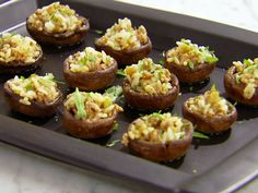Sandra Lee's stuffed mushrooms come with an Asian twist. She uses rice in place of traditional breadcrumbs, brings in a little meat with the pork, and amplifies the dish with soy sauce, ginger and cilantro..