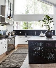 Big windows. Timber flooring kickboards under kitchen cabinets.