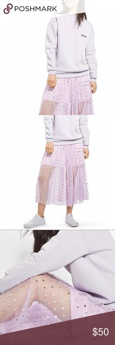 🌹DONATING 3/6🌹 TOPSHOP Foil Dot Pleat Midi Skirt PLEASE FORGIVE SPLIT PHOTOS. POSHMARK UPDATES WONT ALLOW MY APPLE PRODUCTS TO CROP.  Zip closure, lined, pleated tulle, midi skirt, silver polka dots. 100% polyester. Machine wash, line dry. Topshop Skirts Midi