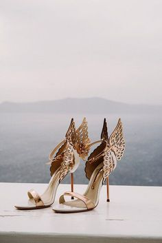 These gilded Sophia Webster heels make our hearts flutter. With angelic wings, these are a pair of statement shoes if we ever saw one.