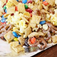 If you're looking for the perfect chex mix, look no further! This one with chex, white chocolate, popcorn, pretzels, and M&Ms is the best!