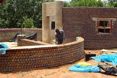 Africa's First Plastic Bottle House Rises in Nigeria Africa's First House Made of Plastic Bottles in Nigeria – Inhabitat - Sustainable Design Innovation, Eco Architecture, Green Building Earthship, Plastic Bottle House, Recycle Plastic Bottles, Recycled Bottles, Eco Friendly House, House Built, House Made, House 2, Green Building