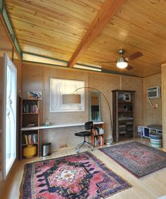 Inside the 14'x20' studio are natural birch plywood walls, a pine tongue-and-groove ceiling, and carbonized bamboo flooring.