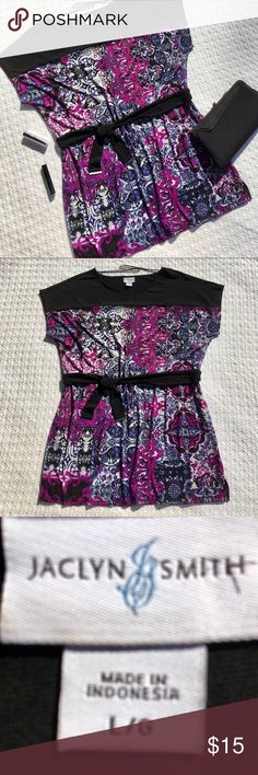 """JACLYN SMITH VIBRANT MULTICOLORED TUNIC WITH BELT ...BEAUTIFUL BOLD, VIBRANT JACLYN SMITH MULTICOLORED TUNIC WITH BELT.  Vivid gorgeous colors: purple, pink, black, gray and blue on white background.  Pairs well with black dress pants or jeans.  The belt cinches in your waist to show off your curves.  95% polyester and 5% spandex.  Details:  remove belt-machine wash cold, gentle cycle. Tumble dry low.  Measurements:  30"""" length and 23""""chest.  Also, 2.5"""" side split down by the hem.  PERFECT…"""