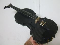 """Last year i made a carbon fibre violin , I started out by drawing a violin on paper , working out the curve heights , plotting the lot on paper , Once i had my plans drawn it was time to start making moulds , the violin plate moulds started as block of plaster , that iroutedout and fine carved to produce a """"plug"""" , the 1st mould was taken off that , then fine finishing the top and bottom plate mould took about 1 month , and i still had..."""