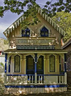 Traditional Gingerbread Cottage...yellow and blue with a porch!!! What more could you want?