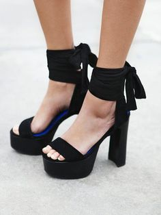 You can never go wrong with a platform shoe. Black sandals heels summer for women.