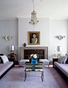 Designer David Collins shows off his mastery of color and design in this gorgeous living room, complete with barely there blue walls.