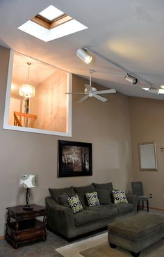 Family room with vaulted ceiling and track lighting