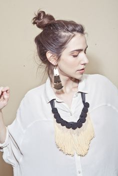 Black button and fringe necklace - textured fabric over loose pastel shirt
