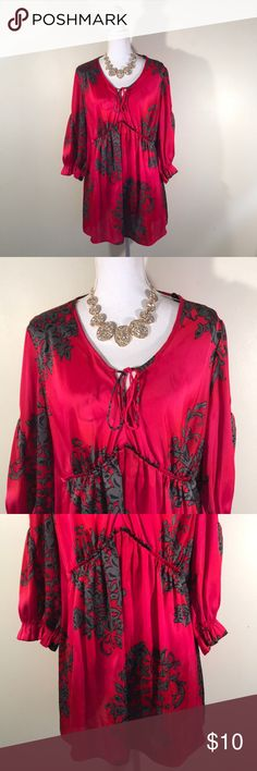 """🍀March Madness🍀NWOT! Evolution Stunning Top IN EXCELLENT CONDITION NO FLAWS! Feels like silk! Absolutely beautiful! Armpit to armpit 24""""/ shoulder to hem 30""""/ shoulder to cuff 3/4 sleeves 19""""  You can only purchase up to 8 items per order. You can place as many orders as you want, or reposh what you buy. Happy Poshing! EVOLUTION Tops Blouses"""