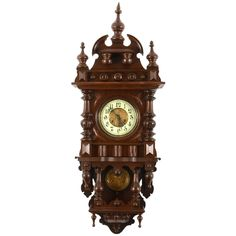 Antique German Victorian wall clock in walnut Renaissance Revival style with porcelain dial and key wind movement, circa 1890.