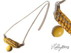 lange handmade Kette in Gelb und Grau mit gelber Perle aus Gliederkette (Metall), Textilgarn (100 % Baumwolle); Länge: 90 cm; Preis: 30 €