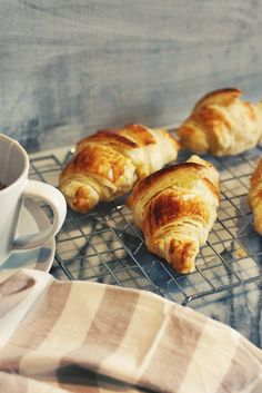 Lemon Curd Croissants | Winter is a time to celebrate all things citrus! Lemons, oranges, limes and grapefruits are all at their best and can brighten up the most humble and plain of ingredients.  This recipe is almost too simple to call a recipe. It features good quality store-bought all butter puff pastry, and homemade lemon curd. That's it…and really, what else could you possibly want? | From: fingerforkknife.com