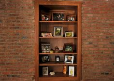 A window opening in the wall of the original home now holds a set of custom-built shelves.