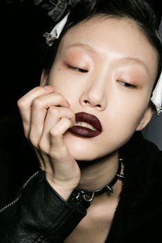 Marni designer Consuelo Castiglioni specifically requested a dark lip for the fall collection. Tom Pecheux applied M.A.C Cosmetics Blind Score Casual Color, followed by Nightmoth Lip Pencil.