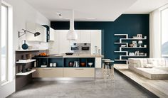 Here's a few kitchen designs that grab you with either a hit of color, or a quirky kind of cabinet layout. Taken from Arredo3 Cucine, there's a fair bit of insp